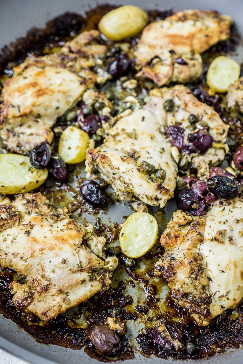 A pan of baked lemon chicken thighs cooked to perfection