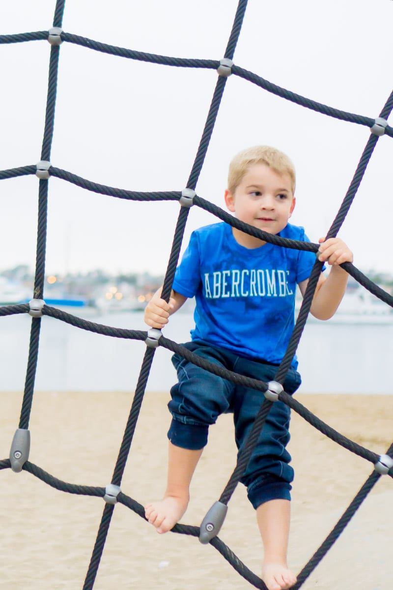 Kid climbing ropes as part of kindergarten activities