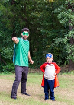 Father and son wearing DIY superhero costumes and DIY superhero mask