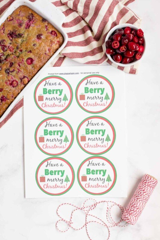 Berry holiday gift tags with cranberry orange bread in the background