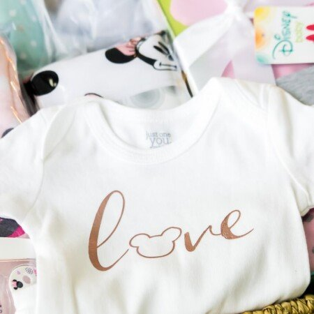 A DIY DIsney onesie and a baby shower gift basket
