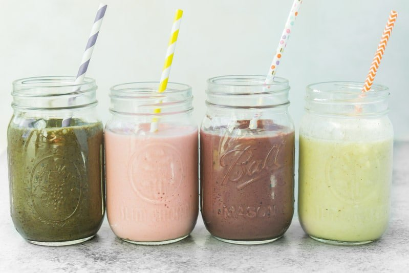 Four healthy smoothie recipes all lined up together