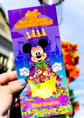 Mickey's Not So Scary Halloween Party map in someone's hand