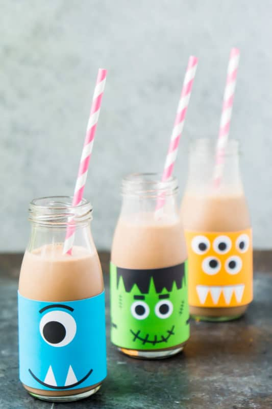 Milk bottles decorated as milk for a Halloween party