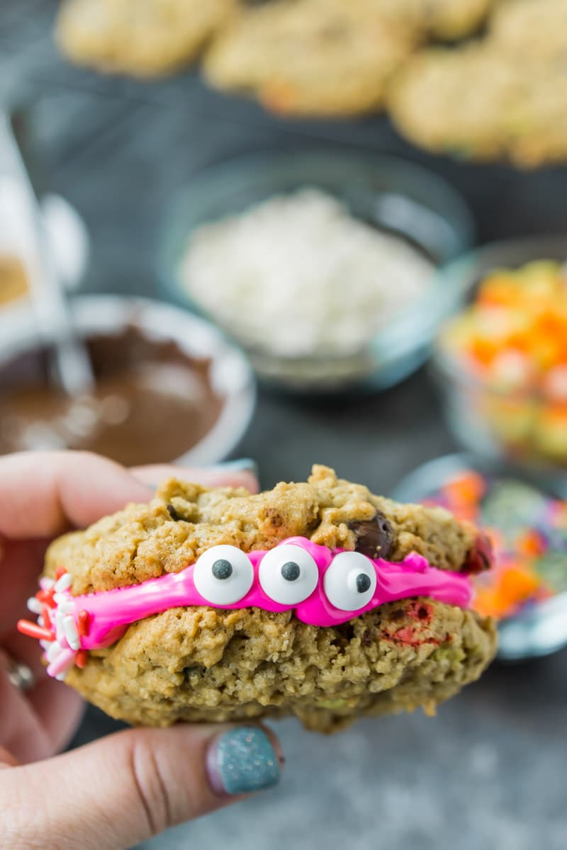 A monster cookie sandwich with two candy eyes