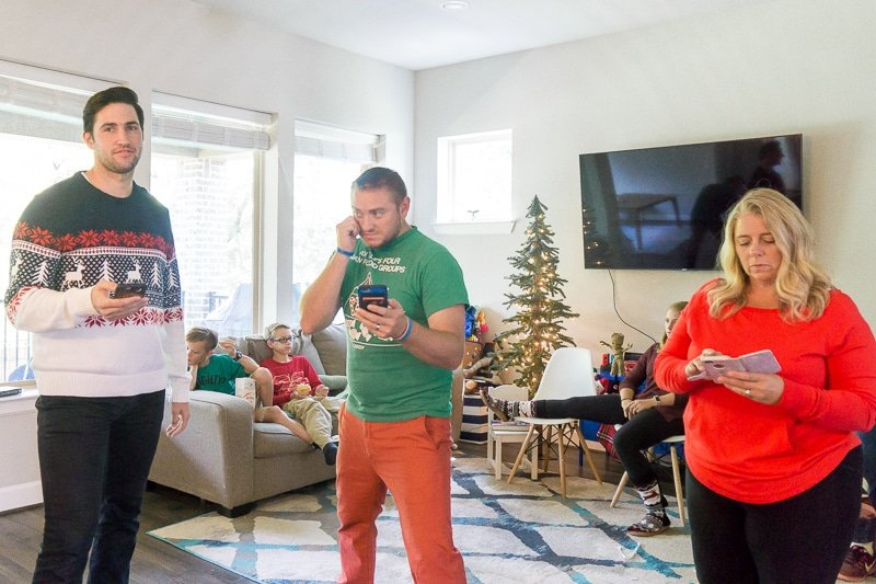 Adults playing Christmas games for adults