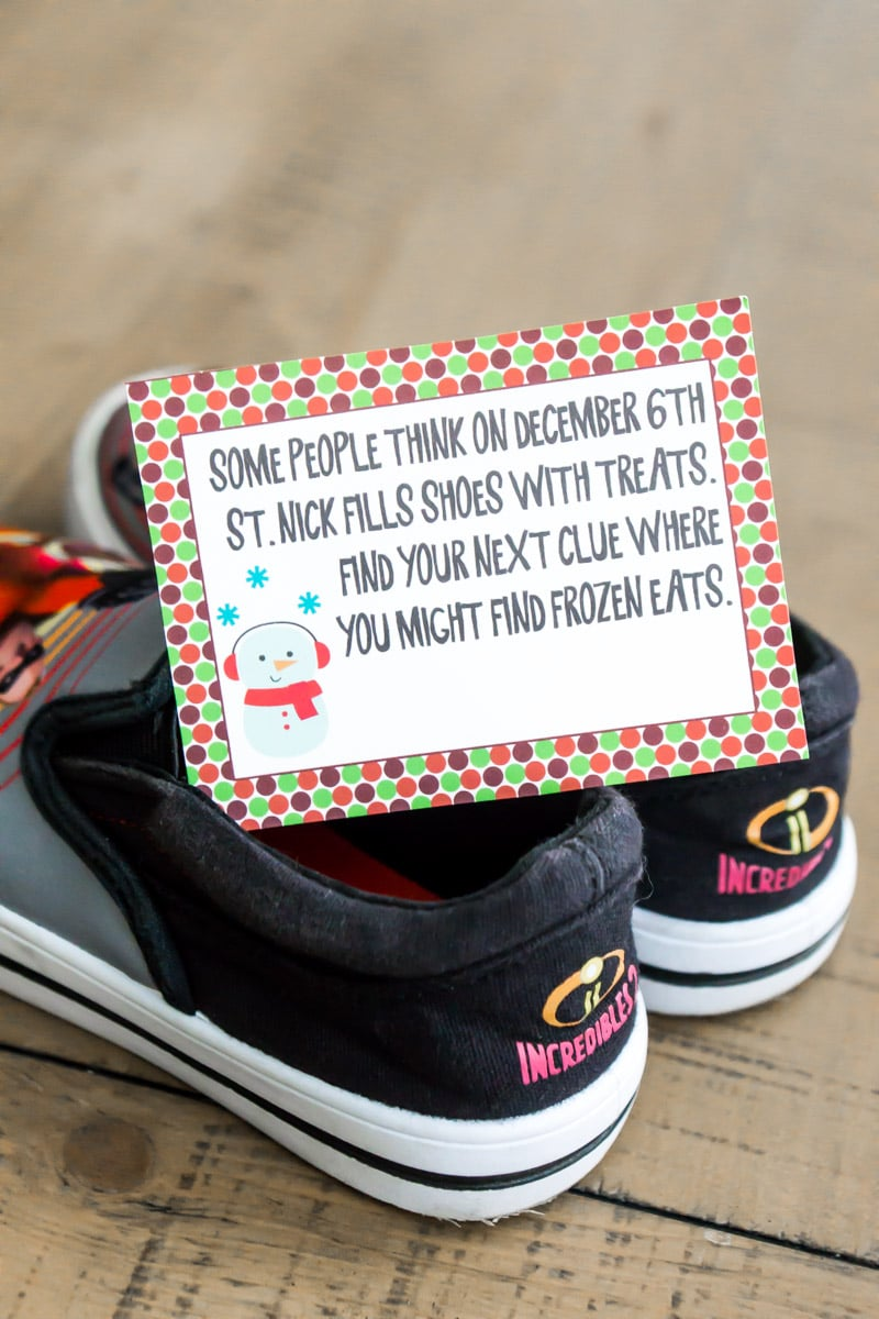 Christmas scavenger hunt clues on a pair of shoes