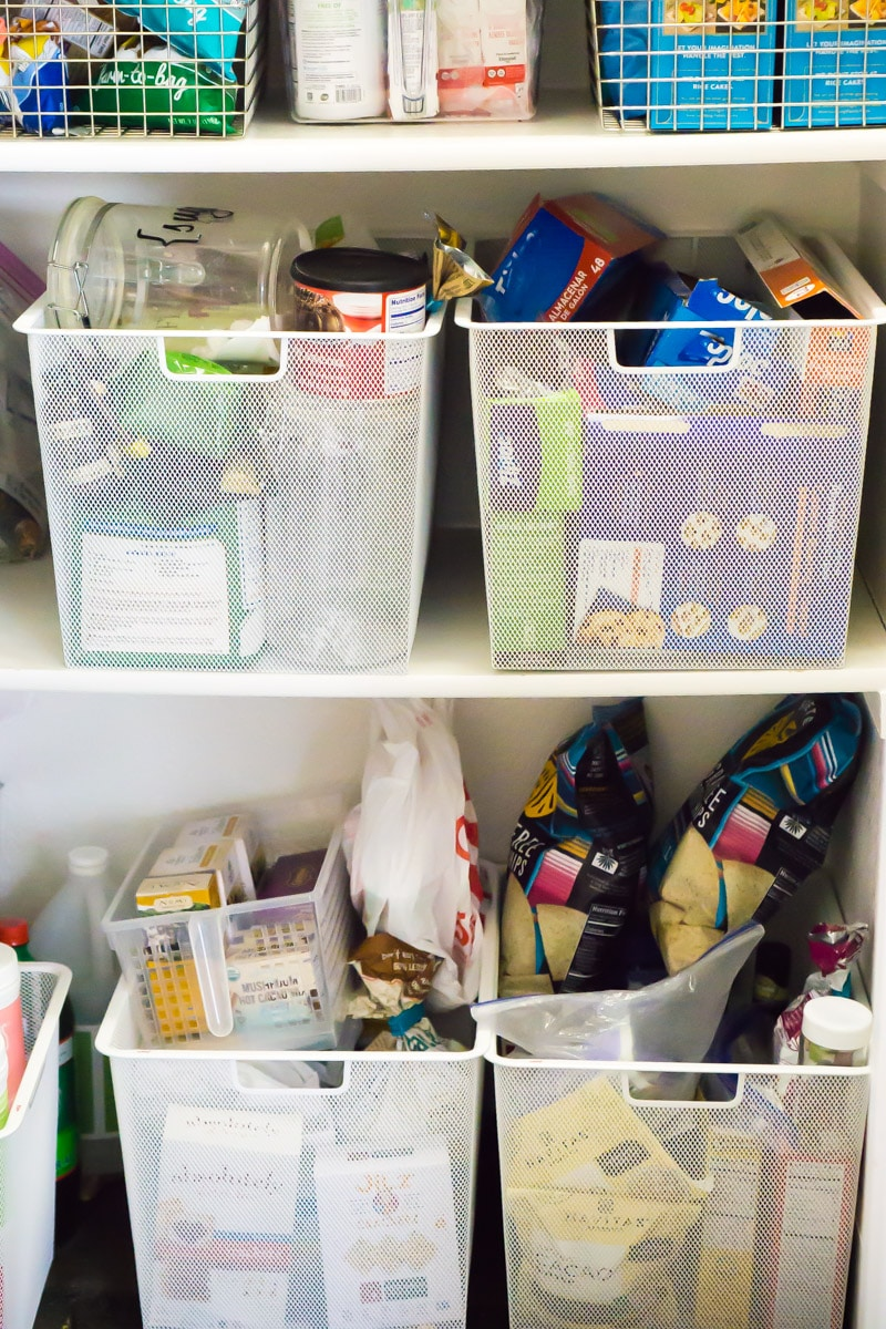 A pantry filled with cute buckets and other tips for showing your house