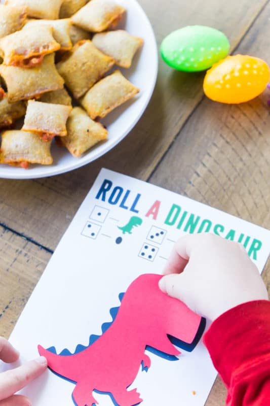Kid playing roll the dinosaur game