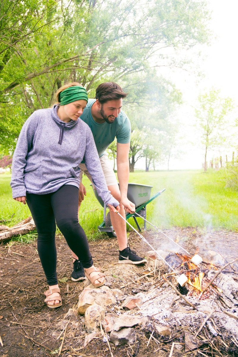 Cooking s'mores at a DIY s'mores bar