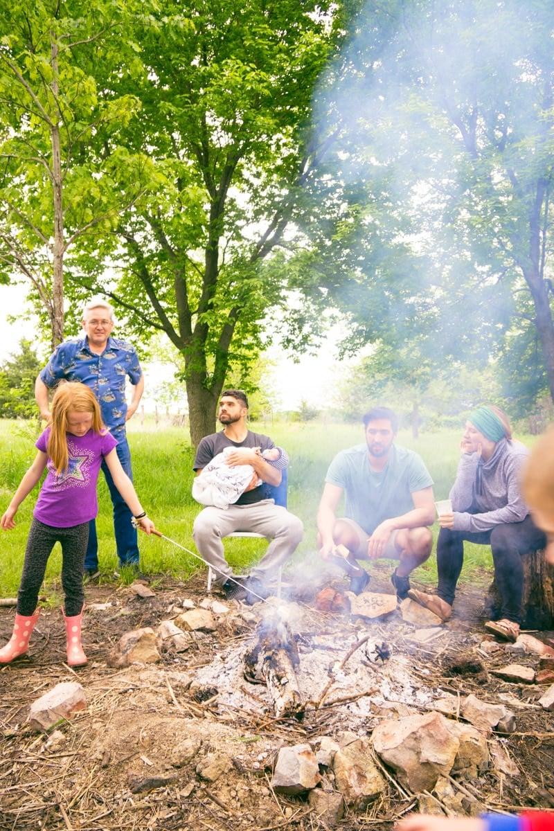 Family enjoying DIY s'mores bar ideas