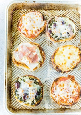 Cooked English muffin pizza on a pan