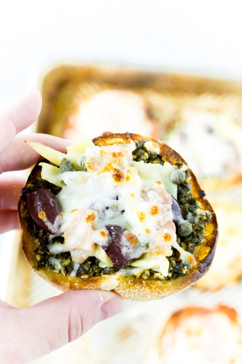 A healthy English muffin pizza with pesto