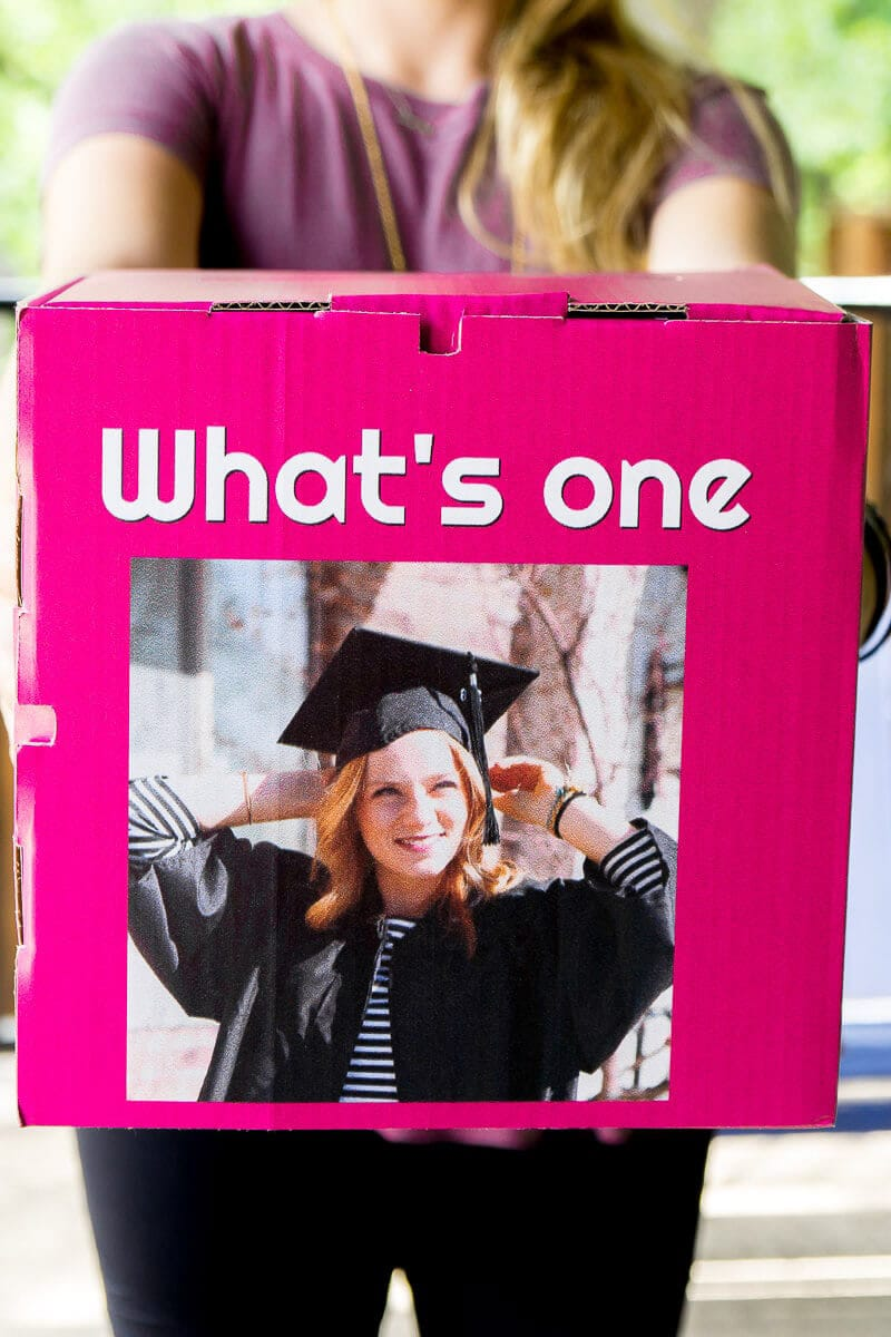 A personalized box filled with graduation gifts