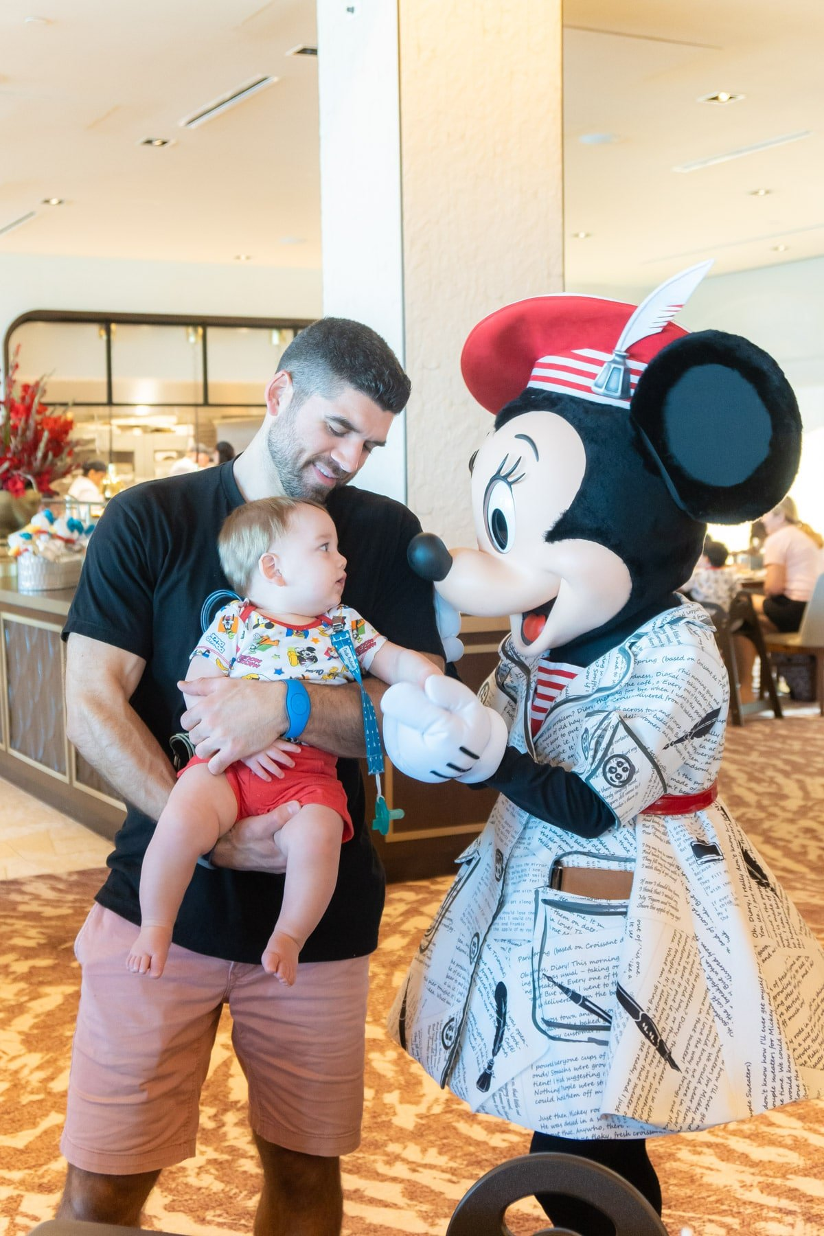 Man and baby with Minnie Mouse