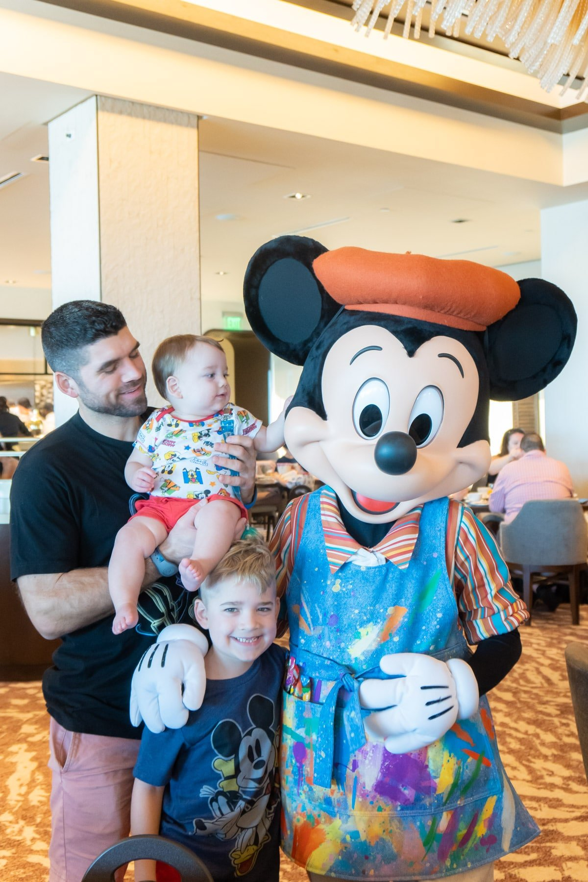 Family with Mickey Mouse in painter's outfit