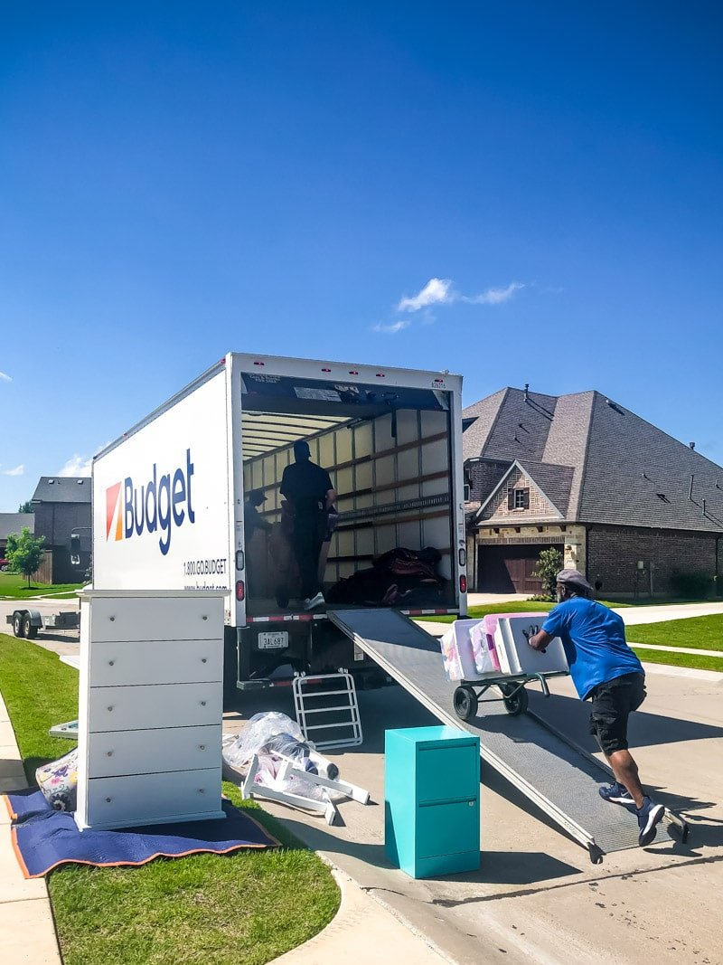 Hire a Helper moving things into a truck