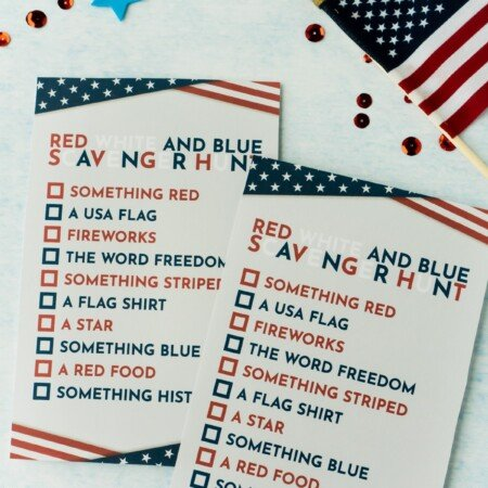 Two printed 4th of July scavenger hunt cards with a flag and confetti
