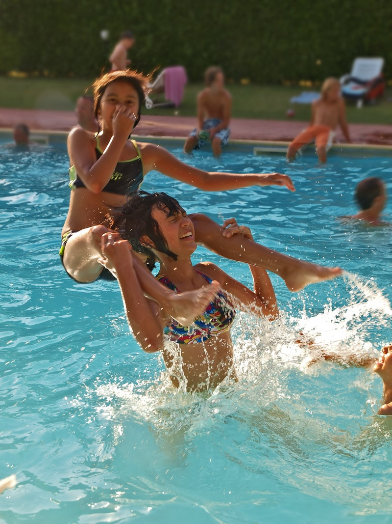Kids having fun playing swimming pool games