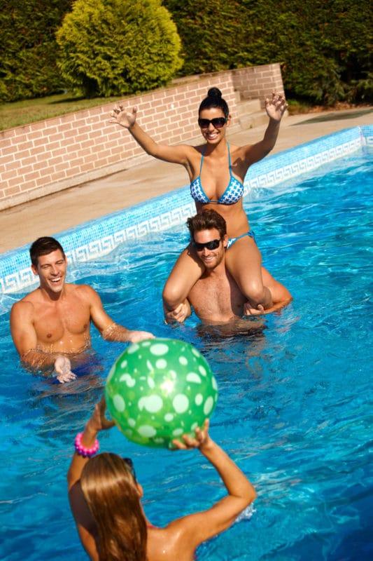 People having fun playing pool games