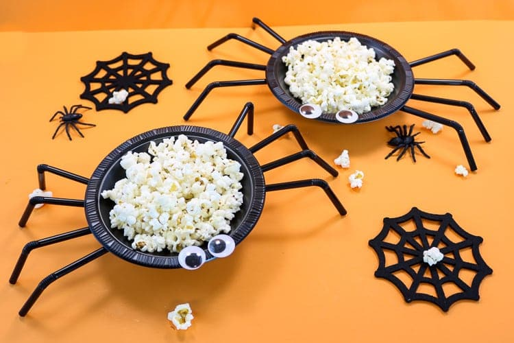 Spider treat bowls with Halloween party food inside