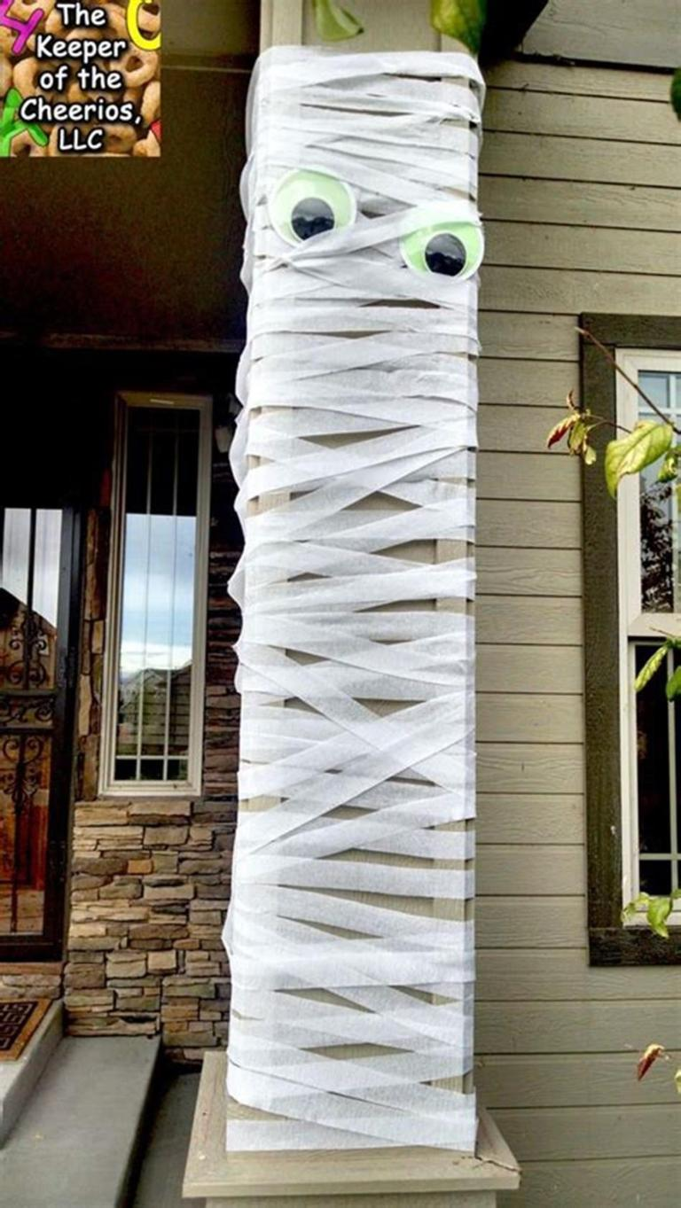 Mummy wrapped pole and other Halloween party ideas