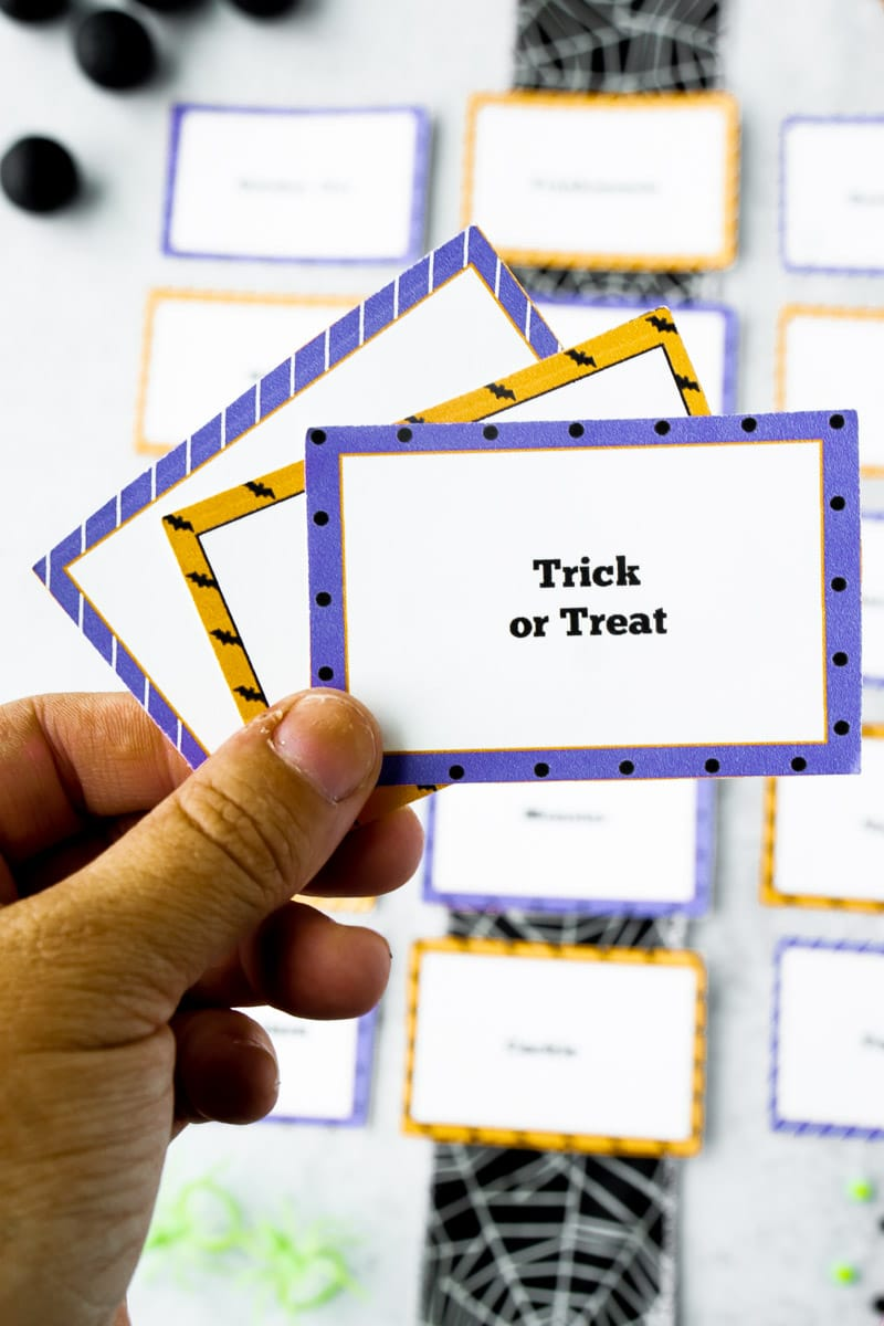 Halloween charades words in a hand