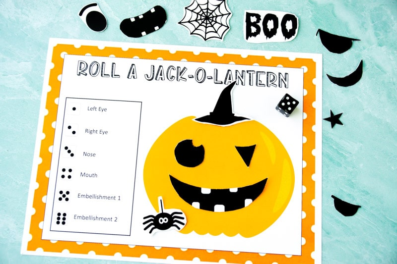 Free printable Halloween game for children! See who can roll a jack o lantern with this cheap and easy Halloween game for kids!