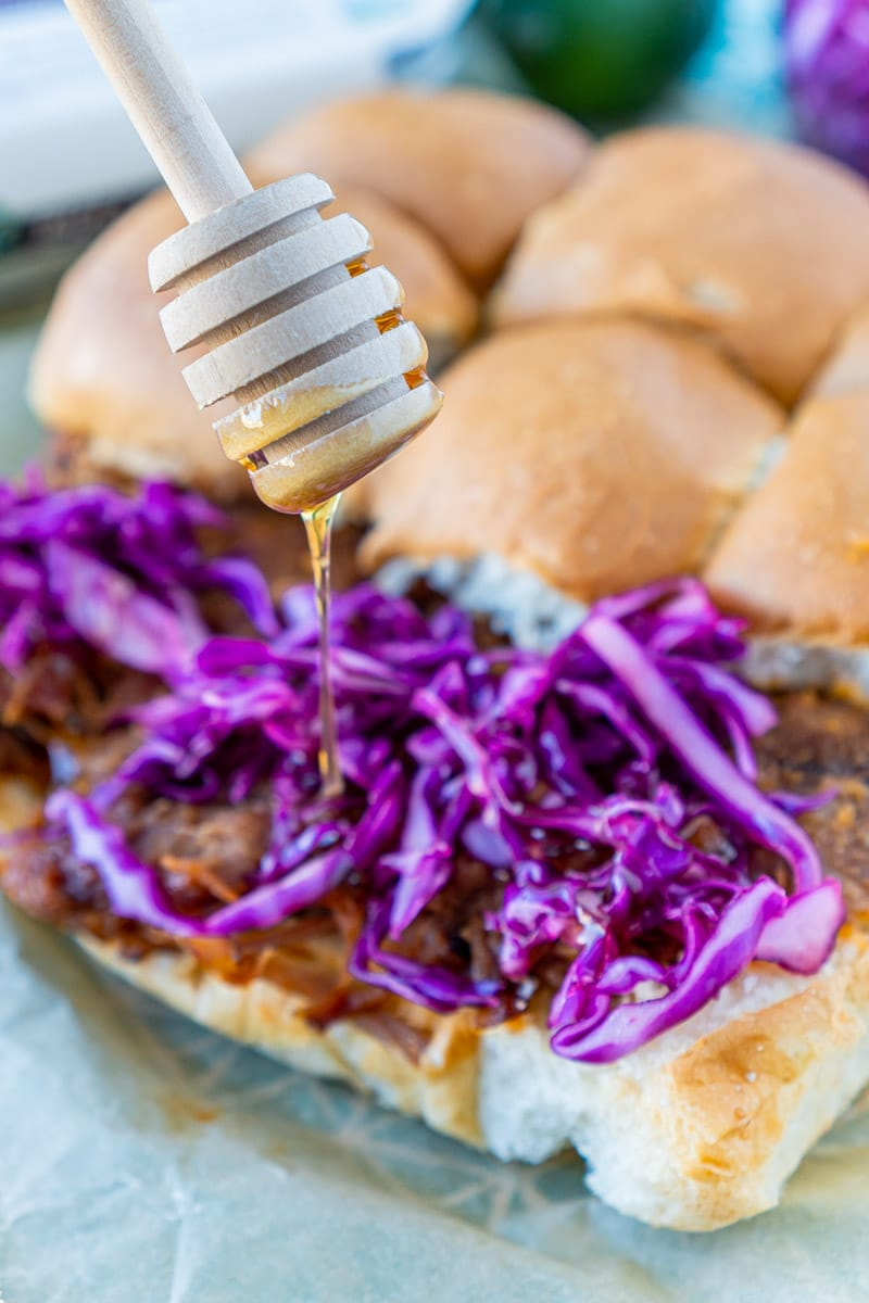 Adding a drizzle of honey to red cabbage slaw