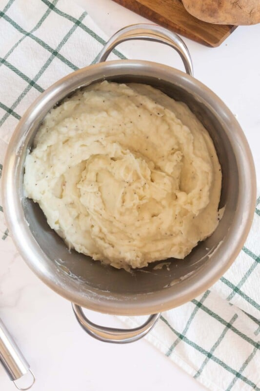 Creamy mashed potatoes in a metal pot