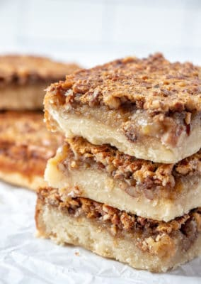Stacked pecan pie bars with shortbread crust