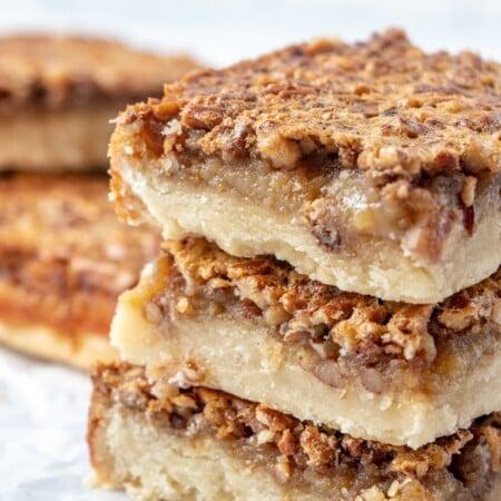 Stacked pecan pie bars with shortbread crust