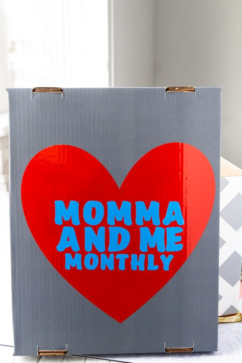 Lid of a box that holds Themed cards to go with personalized gifts for kids