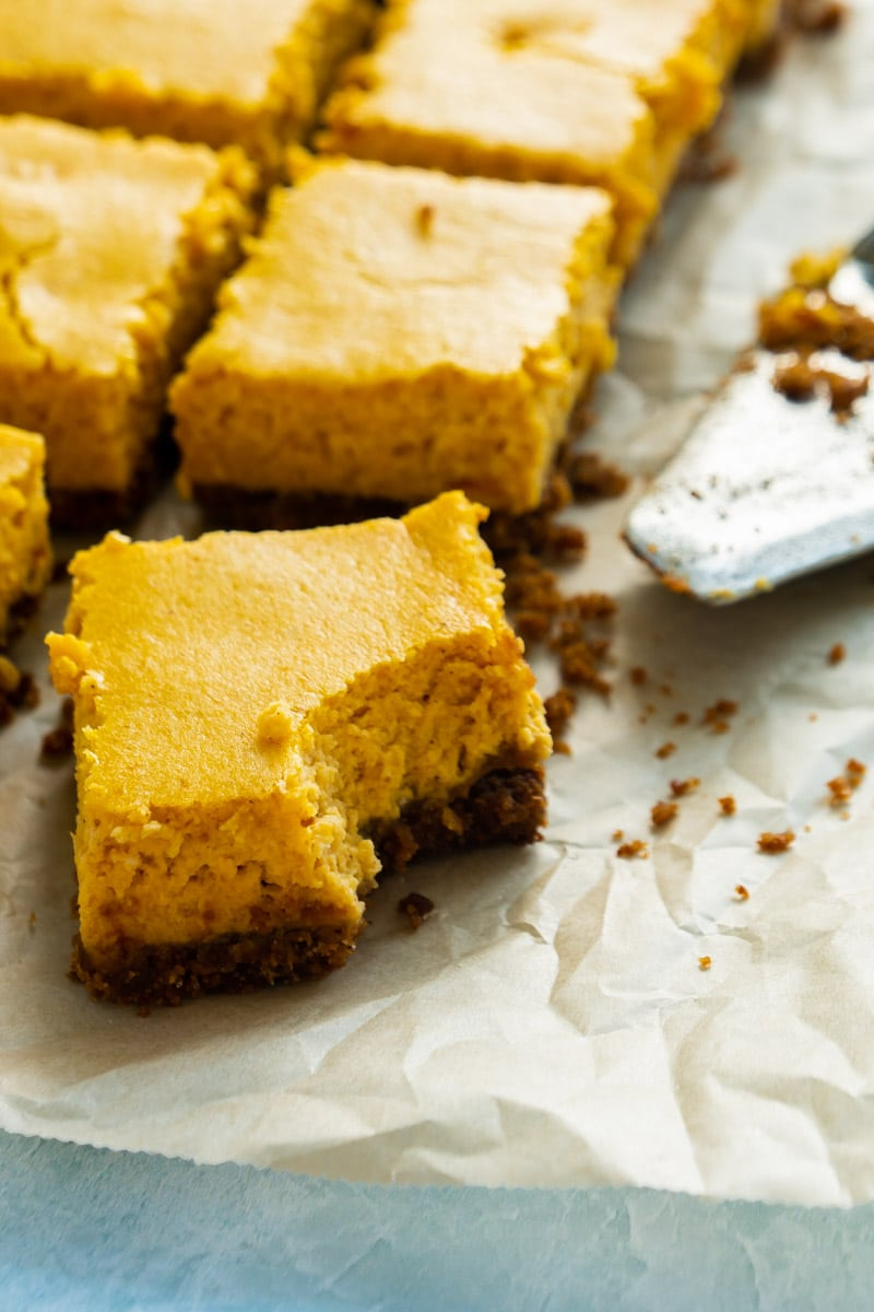 individual pumpkin cheesecake bars with a graham cracker crust