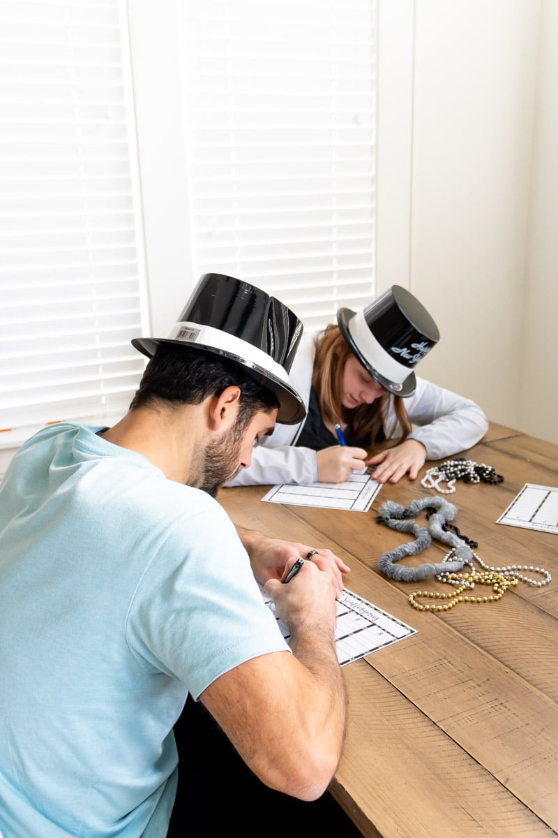 People playing a New Year's Eve scattergories game
