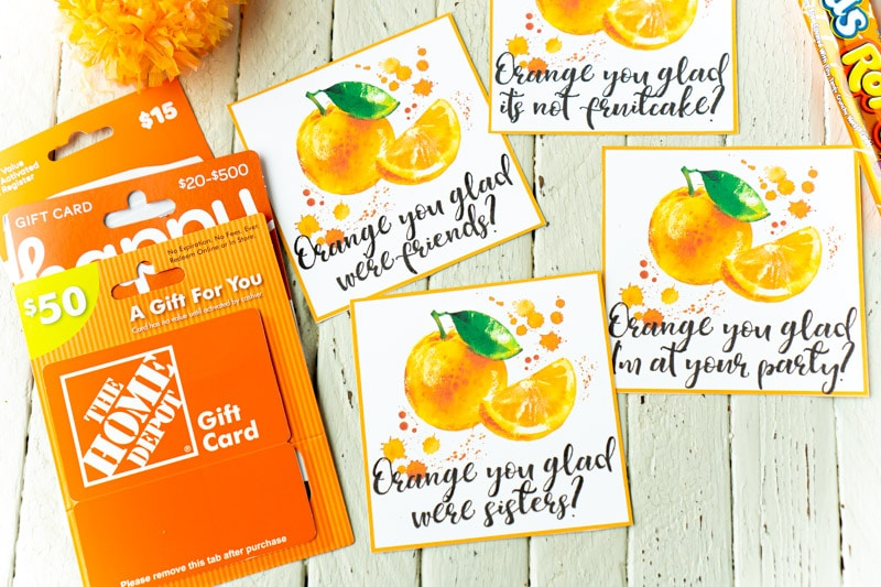 Orange gift tags with a Home Depot gift card