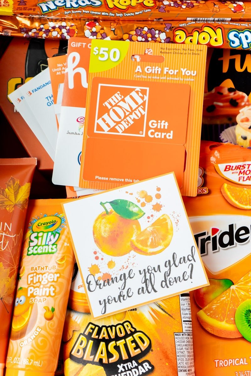 Orange gift tags with a basket full of items