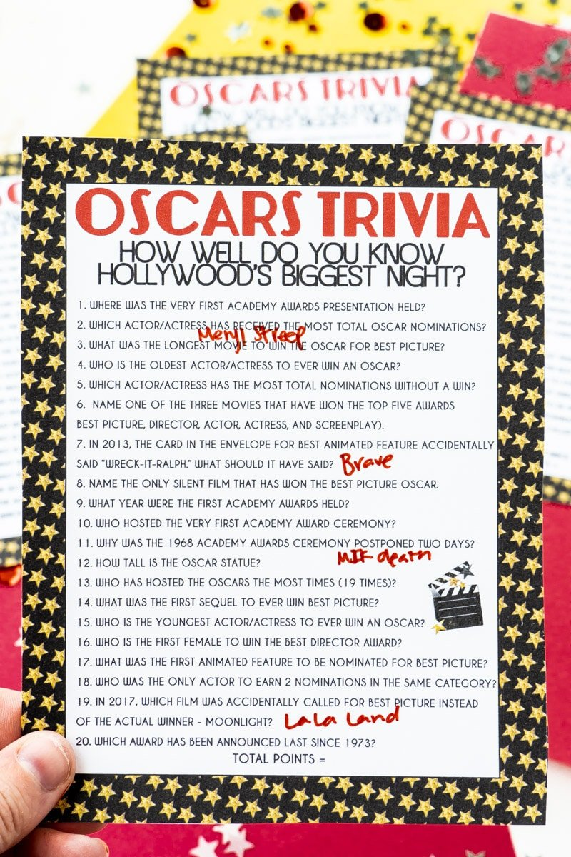 Oscar trivia game held in someone's hand
