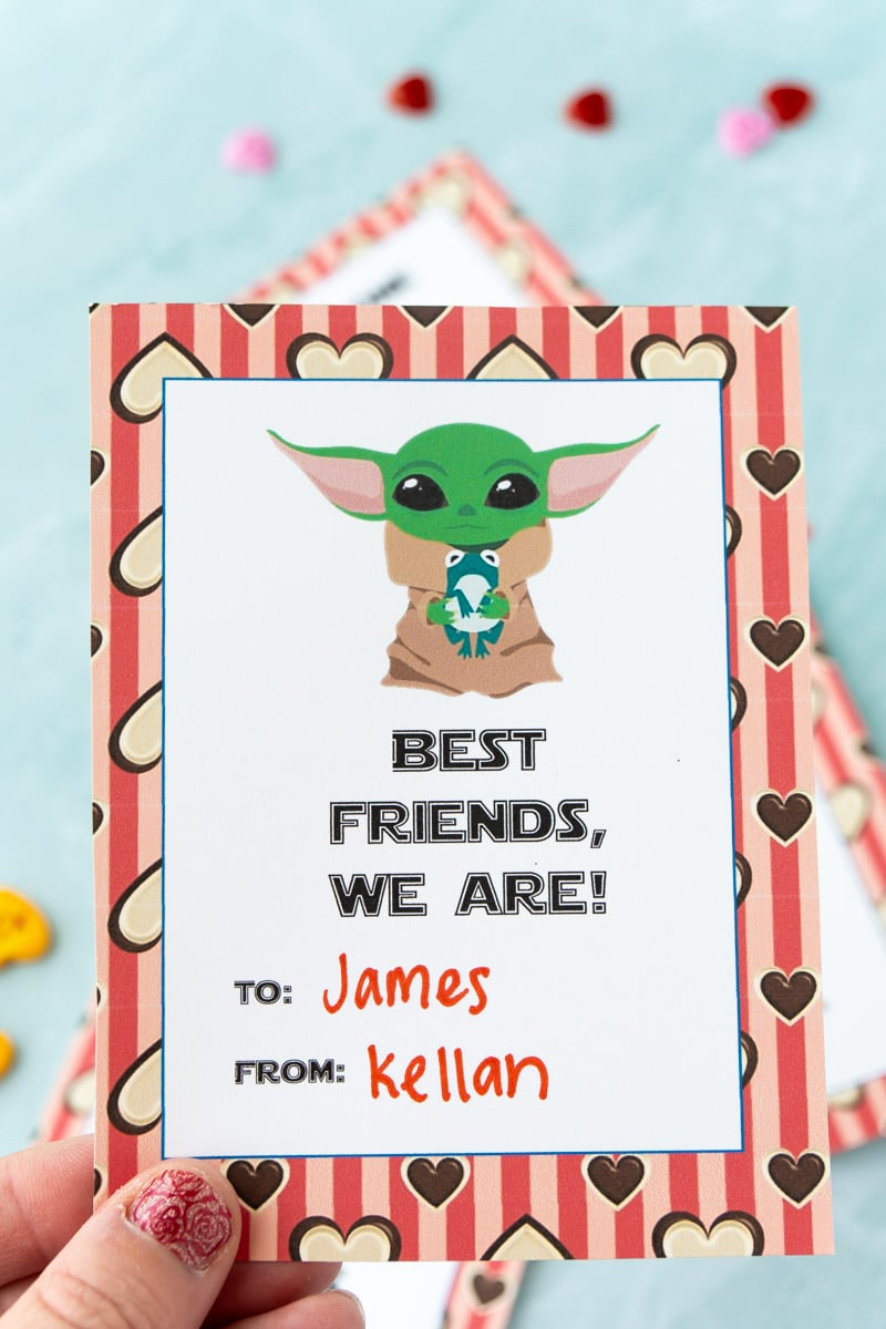 Baby Yoda valentines being held by someone