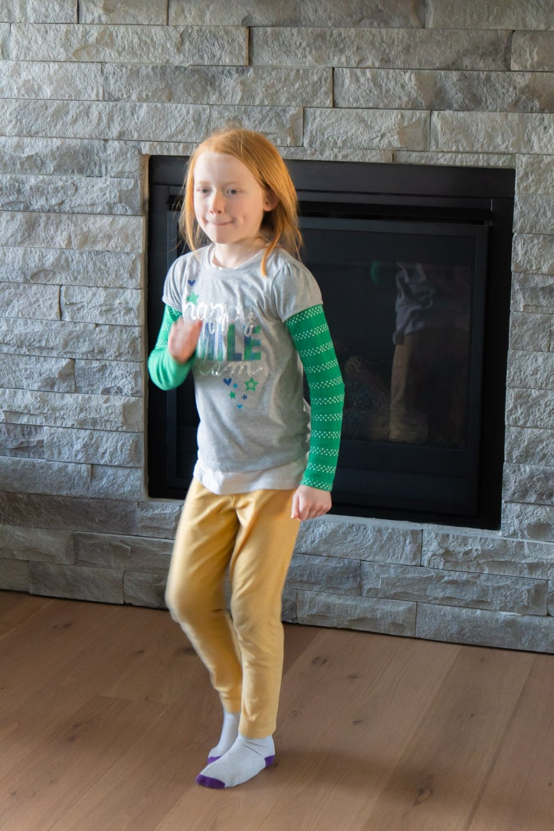 Girl acting out St. Patrick's Day charades words