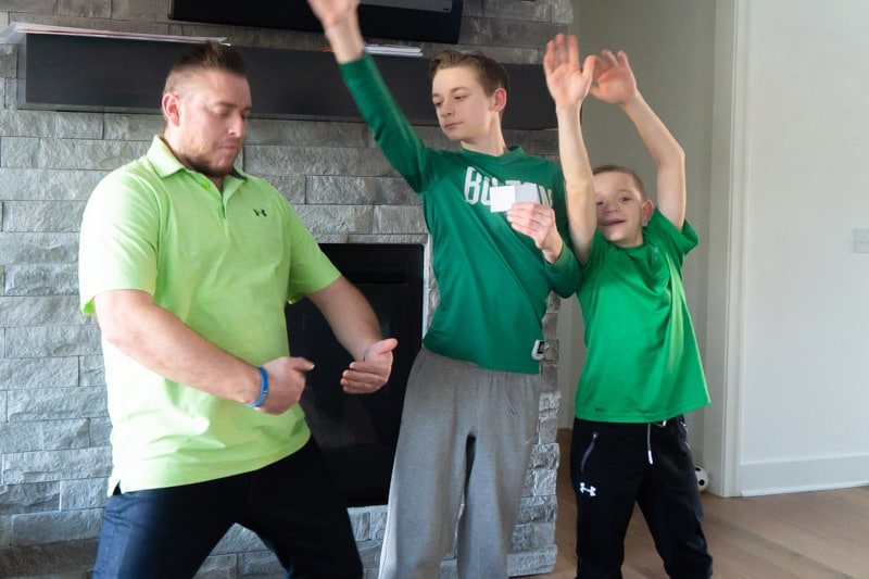 Family acting out a rainbow in St. Patrick's Day charades