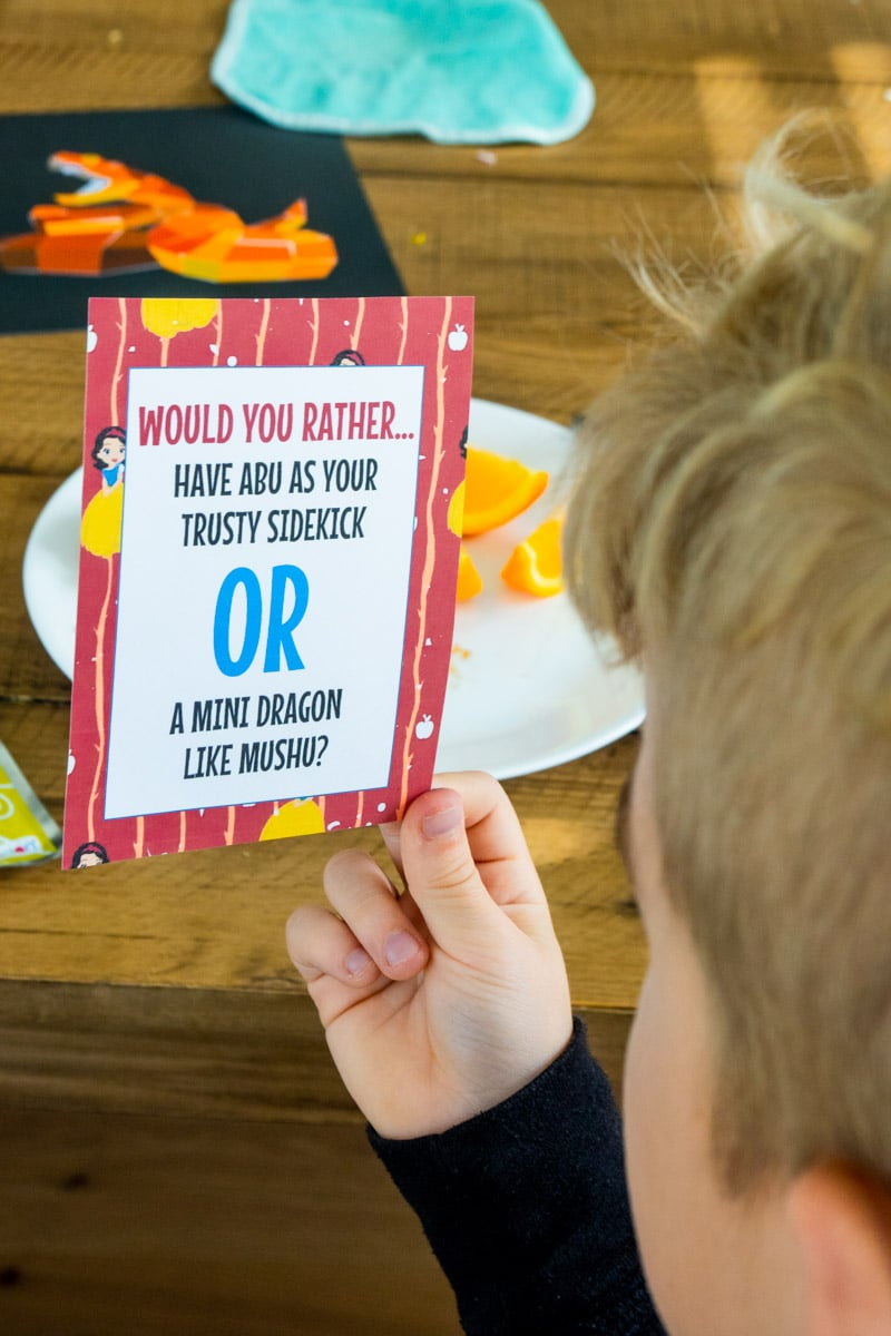 Kid holding Disney would you rather questions