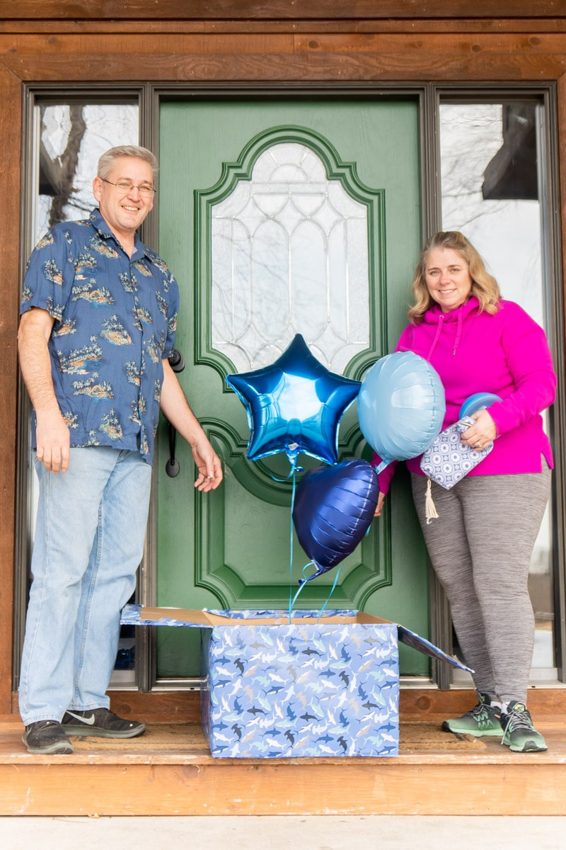 Grandparents holding blue gifts