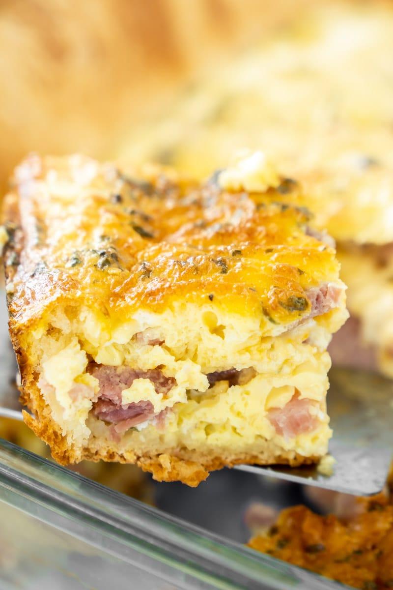 Piece of ham and cheese breakfast casserole