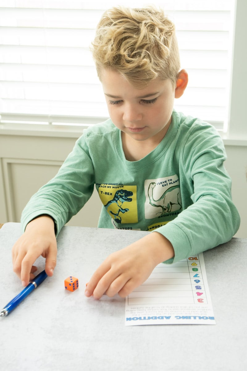 Kid playing math dice games