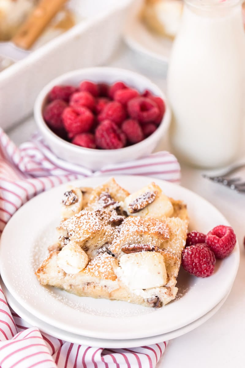 Cut piece of french toast casserole with cream cheese