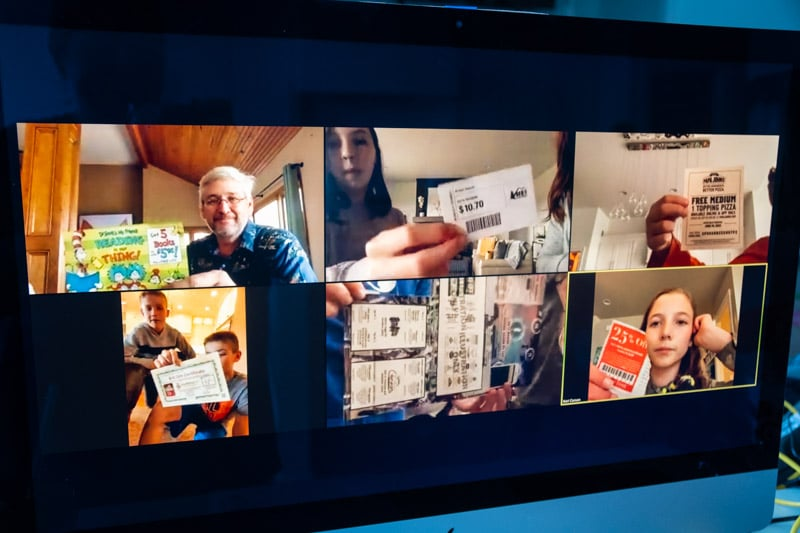 People holding coupons during virtual scavenger hunt