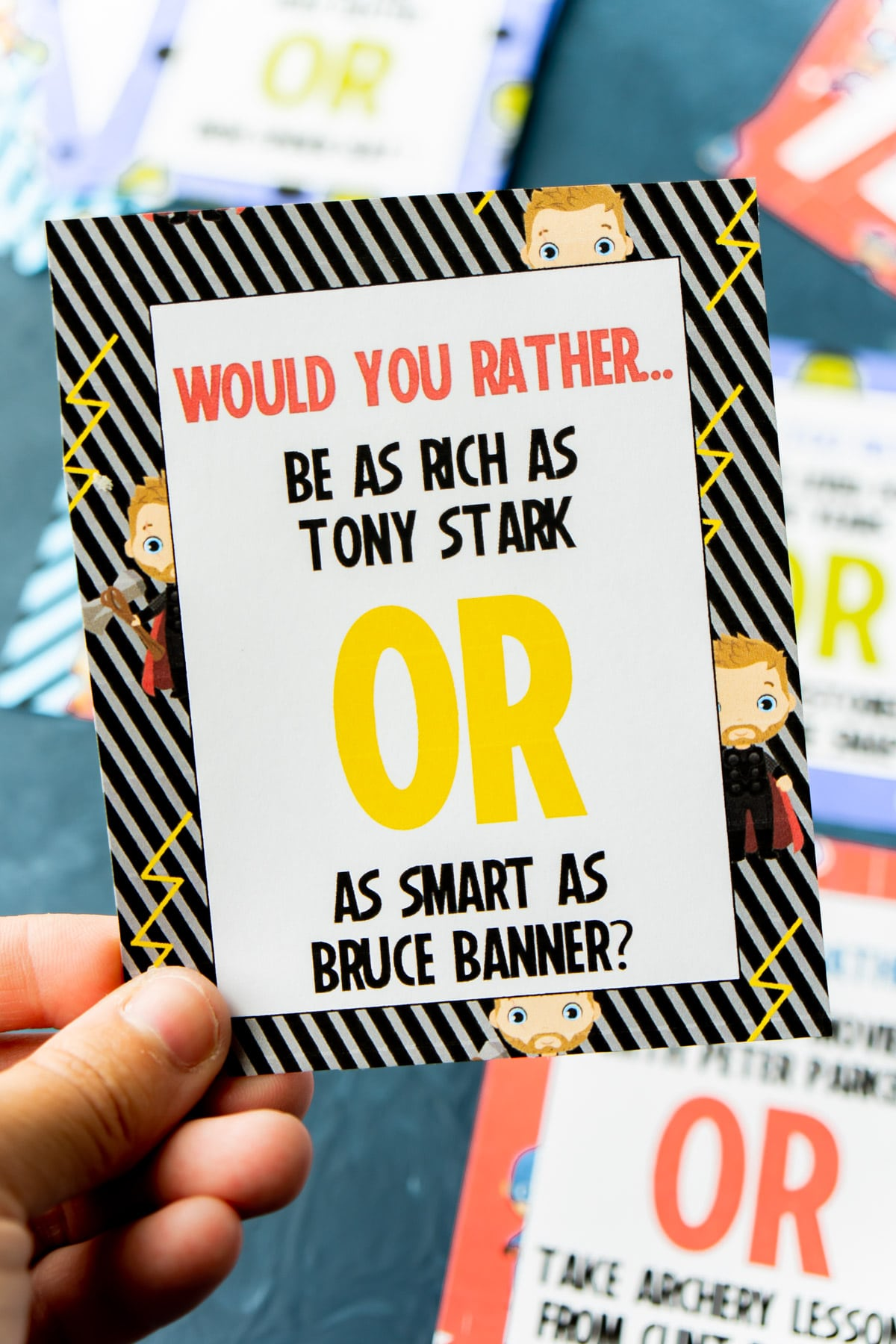 Someone holding a Marvel would you rather question card