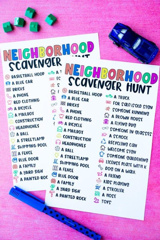 Two neighborhood scavenger hunt lists with toy houses