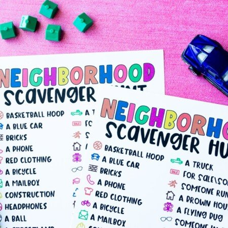 Neighborhood scavenger hunt on pink background with car and house toys